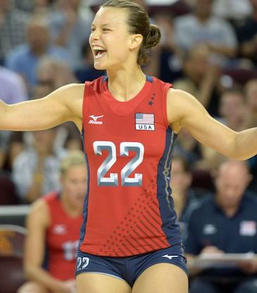 Olympic volleyball setter Courtney Thompson celebrates on the court.