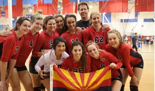 An Arizona volleyball club team celebrates a tournament victory.