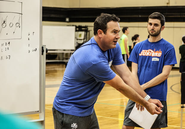 volleyball coach Chris McGown teaches passing during a GMS volleyball clinic