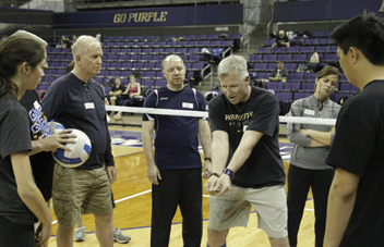 Volleyball coach Jim McLaughlin teaches passing at a Gold Medal Squared Volleyball Clinic.
