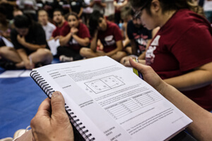 a volleyball coach studies the manual at a GMS volleyball clinic