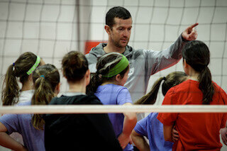 Coach Mike Wall talks with athletes at one of our Summer Volleyball Camps.