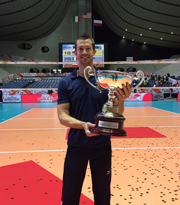 Mike Wall holding the trophy after winning the 2015 FIVB World Cup Volleyball Tournament