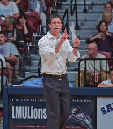 Tom Black coaching the women's volleyball team at LMU